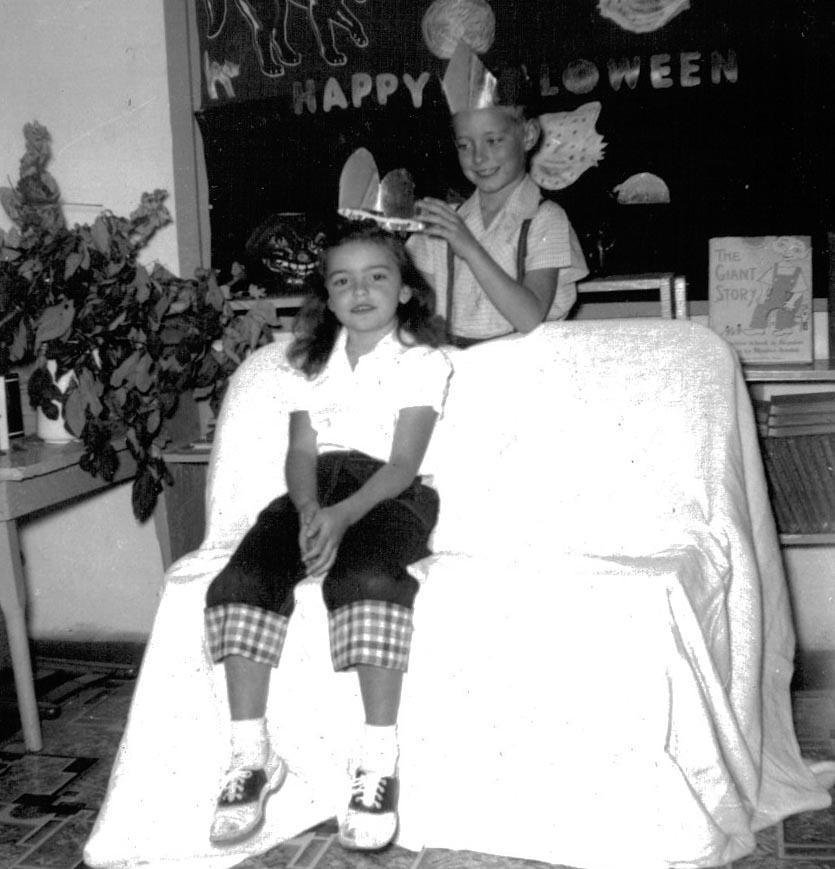 Michael Scoggins crowns Judy Scoggins Halloween Queen at Subligna