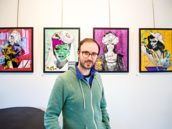 "luke kurtis with his ""muse"" prints at Cyber Blade"