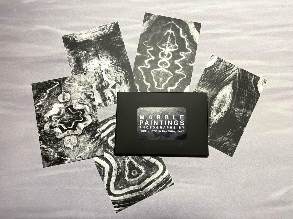 photo of marble paintings postcards set by luke kurtis